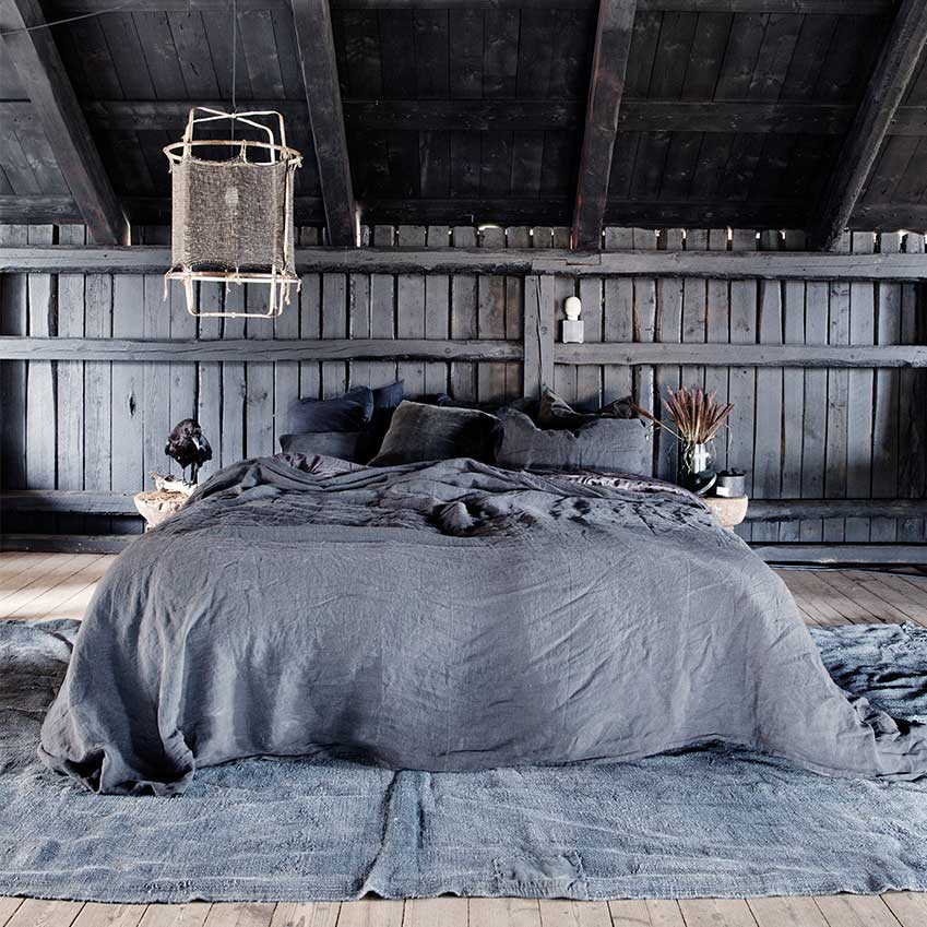 Charcoal hued bedlinen from Milla Boutique and pillows and throws from Housedoctor equals luxe layering perfection. From a home first featured in our February 2017 edition. Photographer: Yvonne Wilhelmsen/House of Pictures