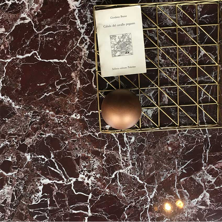 As seen at Italian furniture store Rimadesio, the new coloured marble to watch. Rosso Lepanto marble.