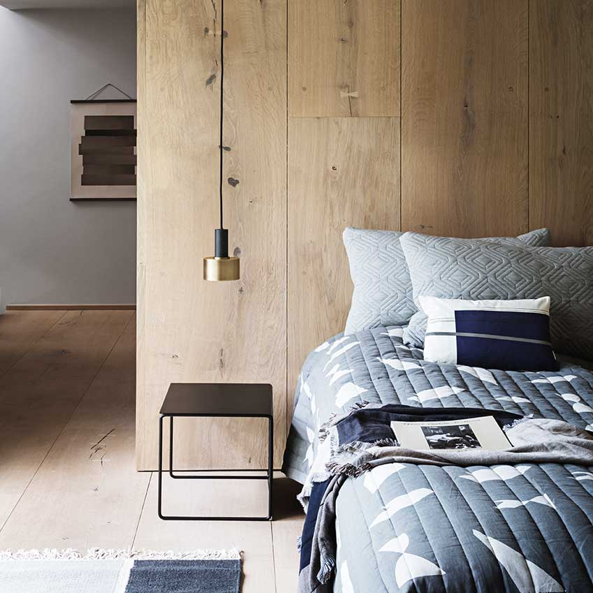 The simplicity of bed + bedside table + lamp = the beginnings of serene sleep. All items by Ferm Living.