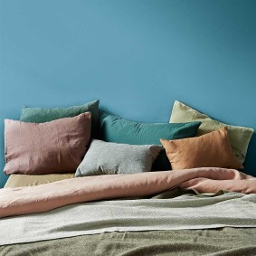 From left Linen cushions, from £6.90 each, VT Wonen (vtwonen.nl); 'Nite' blue pillowcase by Society Limonta, £109, Harrods (harrods.com). 'Gäspa' sheet, from £15; 'Henrika' throw, from £15, both Ikea (ikea.com)