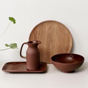 'Olio' serving platter, £35; 'Olio' jug, £40; 'Olio' wooden serving platter, £40; 'Olio' serving bowl, £50, all by Barber & Osgerby for Royal Doulton