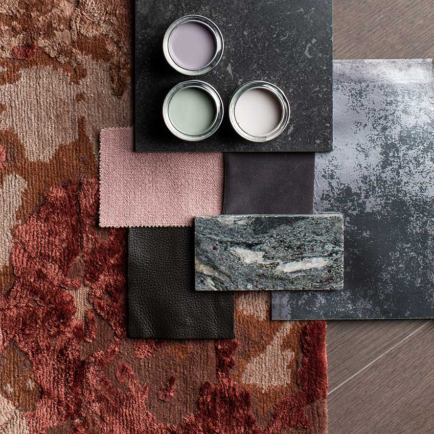 Materials board for the study are of the EDapartment showing the mix of the terracotta Golran rug to the stones, fabric, leather and wallpaper finishes used in neighbouring spaces.