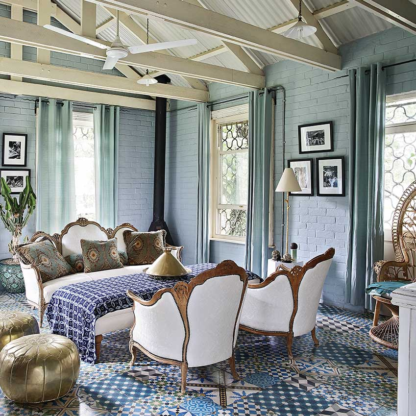 It may surprise some that I love this room from a house in South Africa. Maybe I wouldn't personally live with that sofa, but I absolutely love the overall feel and colour palette of this room, from the exposed, yet painted, thus no longer too raw, brickwork, to its juxtaposition with the delicate curtaining. I love the tiled floor which is a joyous celebration of pattern and colour. And I love the consistent use of gold accents, the exposed ceiling and the filigree detailing on the windows. Something to delight from every angle. First featured in the September 2016 edition. Photographer Elsa Young.