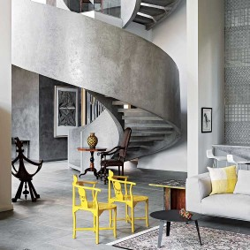 This incredible home in Johannesburg is an architectural wonder, with an expressive use of concrete. The grey though makes the perfect backdrop to a pair of antique chairs that have been custom-painted in a vivid saffron yellow. First featured in the December 2015 edition. Photographer Elsa Young.