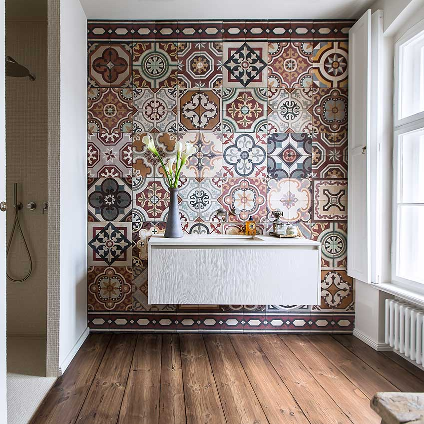 A guest bathroom in this home in Berlin, is totally transformed by these traditional earthy-hued tiles. The owner had been collecting them for many years and said the look she wanted was that of a kilim carpet on the wall. First featured in the September 2015 edition. Photographer: Marc Waldow
