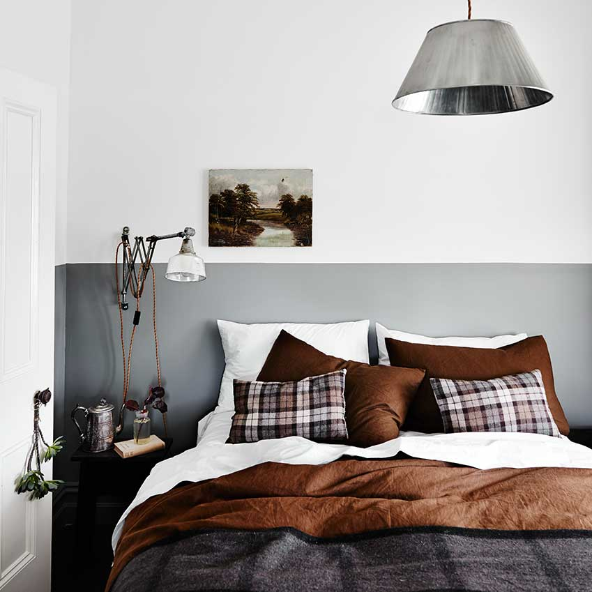 In this Melbourne home, a note of rust totally makes this bed-dressing; but note how it's skillfully tempered by crisp white sheets and a painted grey headboard. First featured in the November 2015 edition of ELLE Decoration. Photographer: Lisa Cohen.