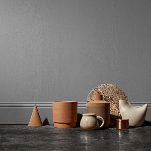 Terracotta is experiencing something of a revival, newly worked into modern forms and looking very contemporary when mixed with cork and marble: from left, cork cone desk accessory, £19, Hay; planter from Anchor Ceramics, £55; lidded pot, try Hend Krichen for similar; marble trivet, £36, Safari Living.