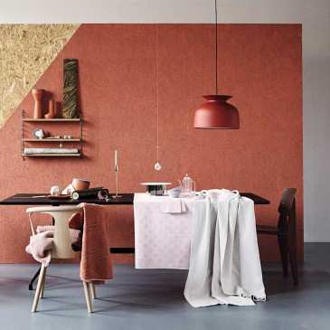 "Pops of terracotta can work well to add warmth, here a wall painted in ""Red Earth"" by Farrow & Ball is beautifully balanced by grey, pale pink and natural woods. The pendant light is by Oliver Schick for Gubi, from £186; the sculptural pots on the shelf are by Benjamin Hubert, from £45 each. And the pale pink throw on the white oak chair (from &Tradition, £329, Nest) is from Society Limonata, and the rust coloured throw is from Missoni Home, £244 from Amara. Styling: Tina Hellberg; Photographer: Magnus Anesund."