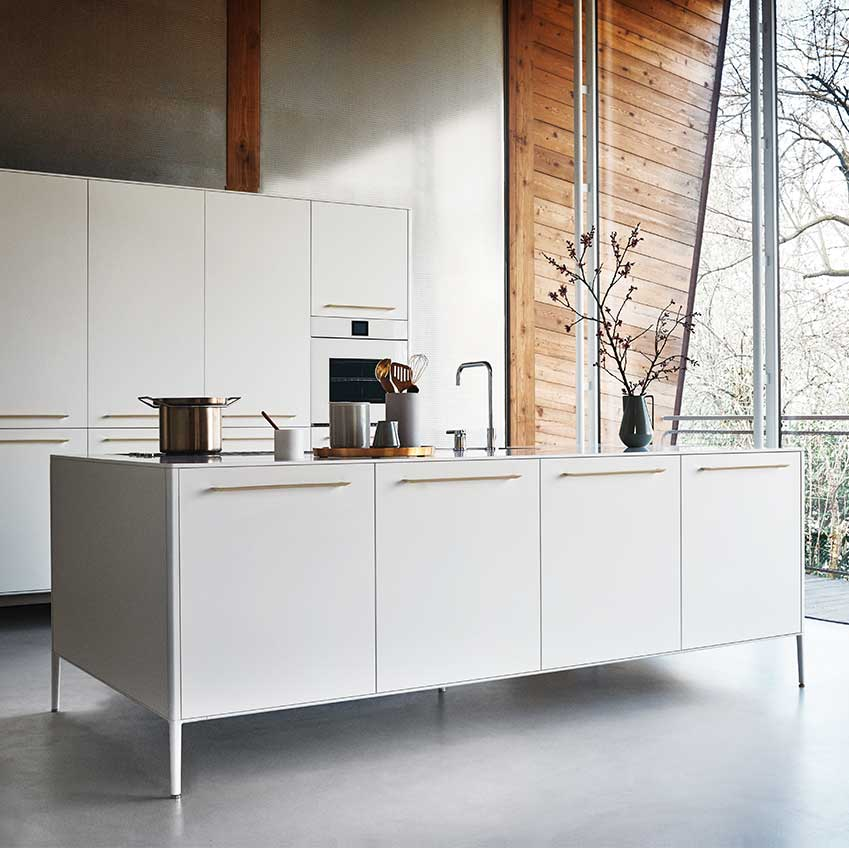 "This ""Unit"" kitchen by Cesar is sleek and sophisticated and anything but boring thanks to brass handles and slimline legs which give it a light and lofty feel. Great too for smaller rooms as being able to see as much floor as possible makes any room feel larger. Prices from £13,276. Cesar.it"