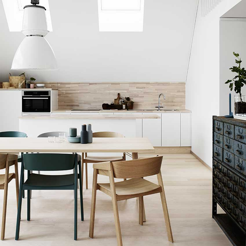 This kitchen in Stockholm features units and a solid ash worktop from the Scandanavian company Vedum. For more details download ELLE Decoration kitchens Volume 1.