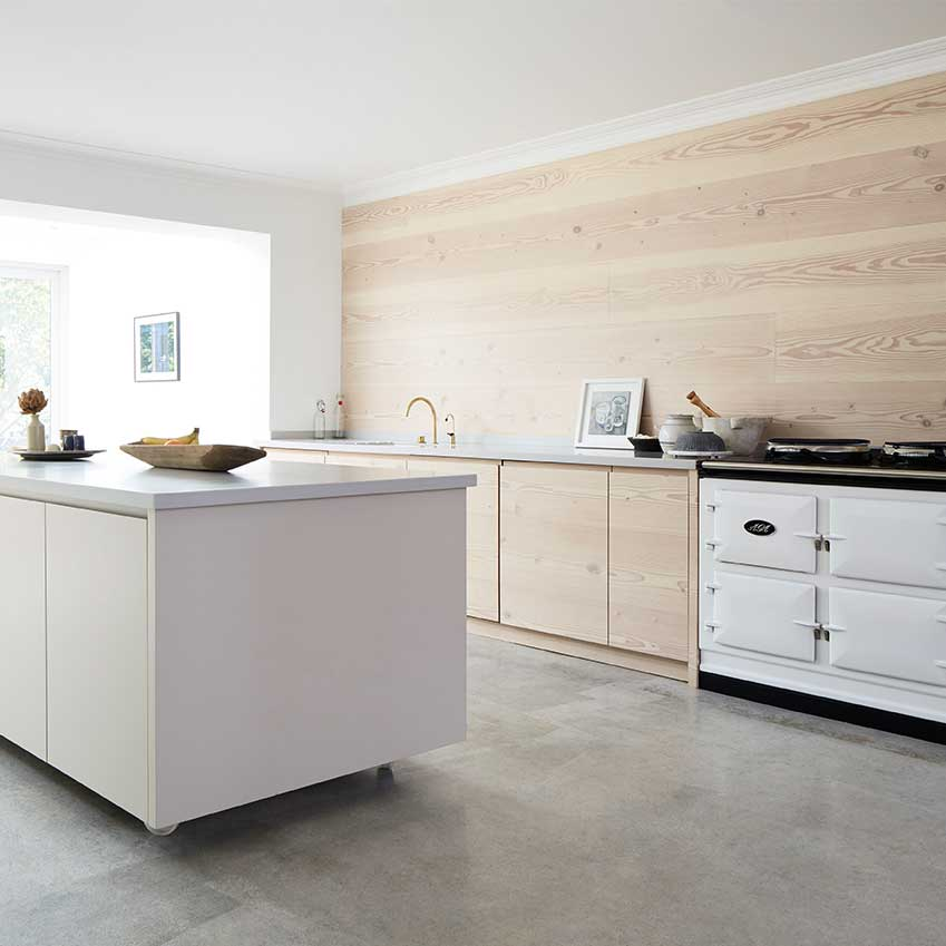 This kitchen designed by Blakes London features an island unit on wheels so it can be moved around this large open plan space. The wall and units are made from Douglas Fir and the countertop is grey Corain. For more details see ELLE Decoration Kitchens Volume 1. Link at bottom of post.