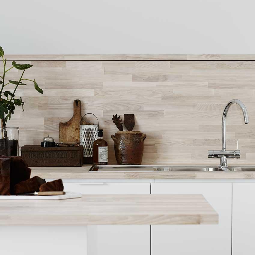 Solid ash makes a striking splashback in this Swedish kitchen. For more details see ELLE Decoration Kitchens Volume 1.