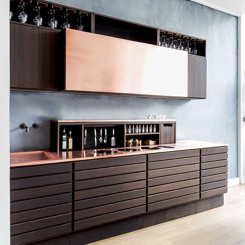This design from Sola Kitchens shows just how modern this material can be. We also love the nifty retractable shelf! For more details see inside ELLE Deocration Kitchens Volume 1. Link at bottom of post.