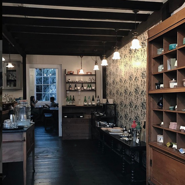 Katsute 100: a Japanese teahouse with shelves of handmade ceramic Yunomi and Chawan tea cups and Japanese whisky bottles, all available to buy. 100 Islington High Street, London N1 8EG.