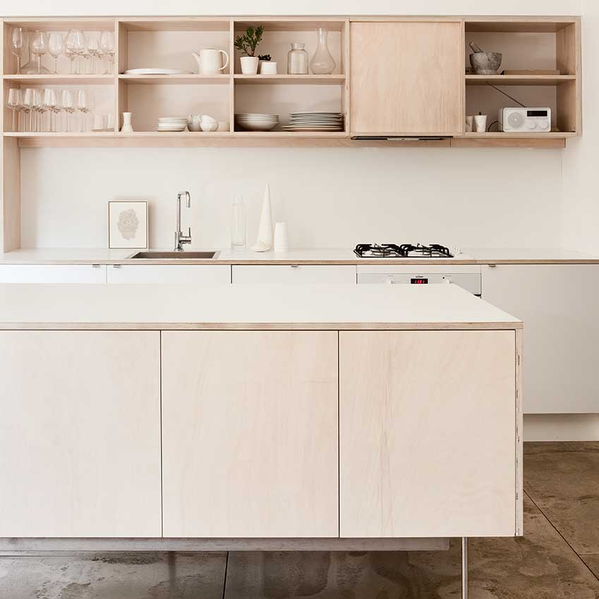 This kitchen was designed by Tribe Studio. The work surfaces are clad in formica to give it a very polished finish. Photograph: Jason Busch