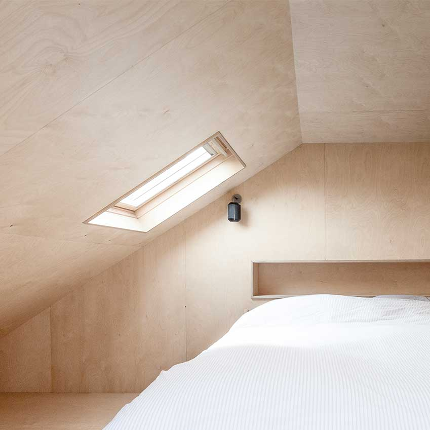 Bedroom in The Plywood House designed by the London-based architect Simon Astridge.