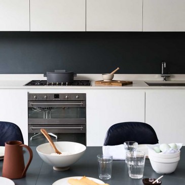 Stylist Sania Pell and family at home in their kitchen.