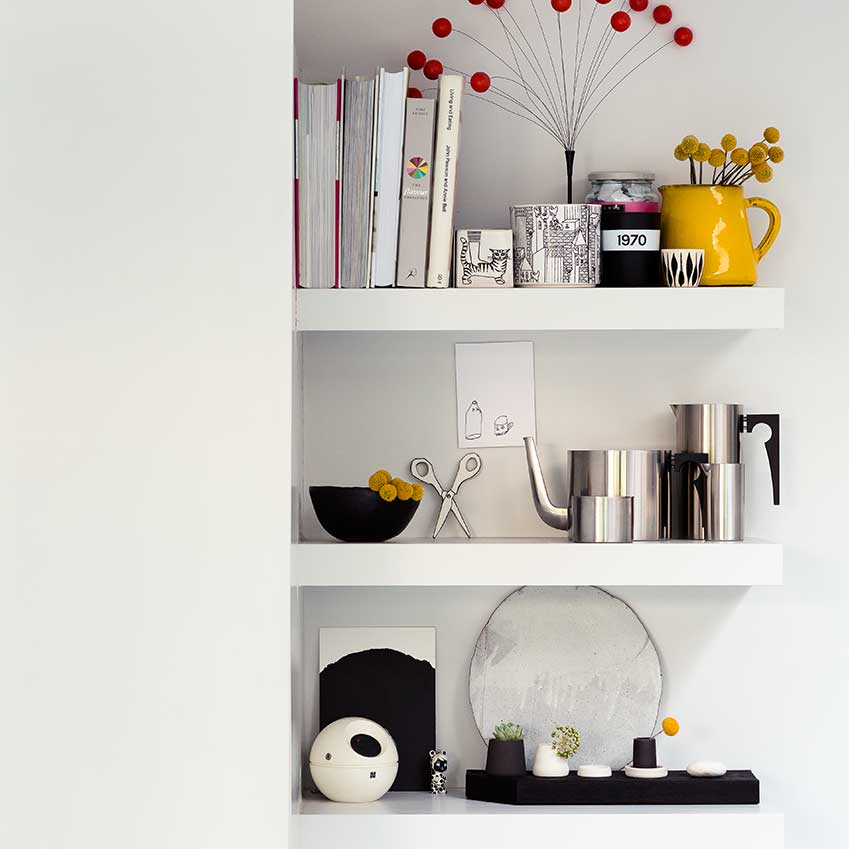 Making the most of every inch of space, shelves snuck into a wall cavity in stylist Sania Pell's multipurpose kitchen, are the perfect place for artwork and favourite things