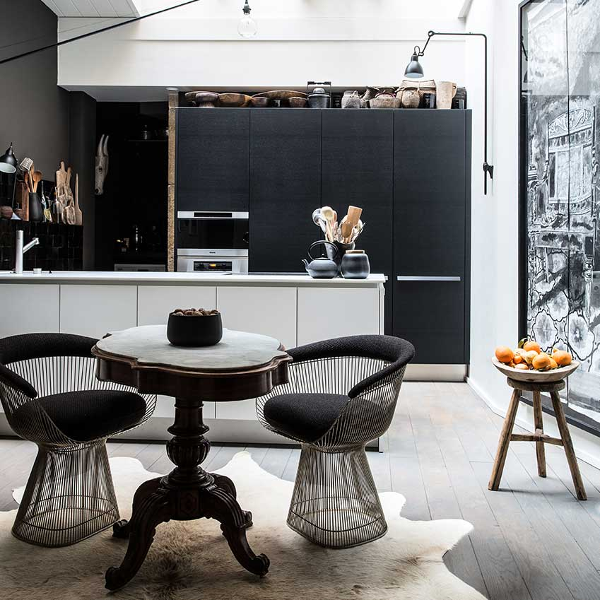 This kitchen is in an elegant apartment in Lyon in which the owner decorated whole rooms in his favourite colour, black. FIrst featured in the February 2016 'Trends' edition of ELLE Decoration. Photography: Felix Forest/Living Inside