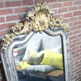 18th Century French mirror reflecting assorted cushions on a George Nelson bench. Photograph: Michelle Ogundehin