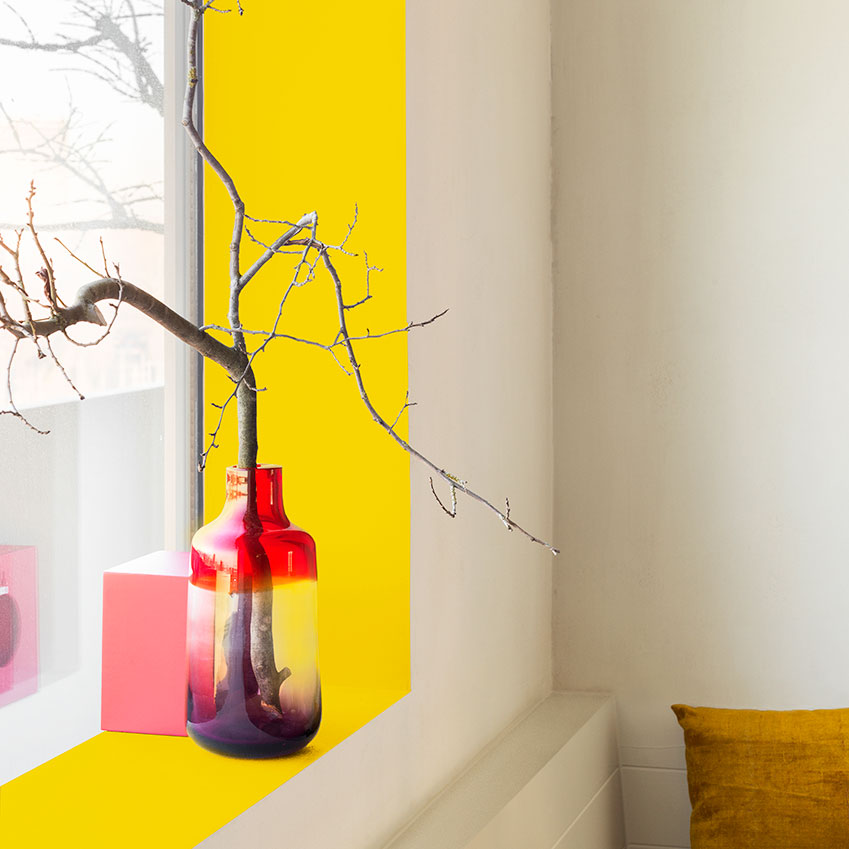A wonderful way to add a shot of yellow to your home is to paint inside the frame of your windows withe the colour. It will have the effect of sunlighting the window!