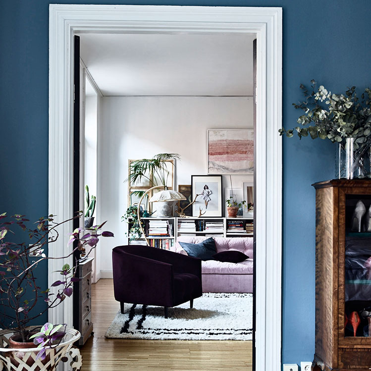 The living room as seen from the hallway, which is painted in an eye-catching Scandinavian blue May 2017 issue: Photos: Sasa Antic/ House of Pictures
