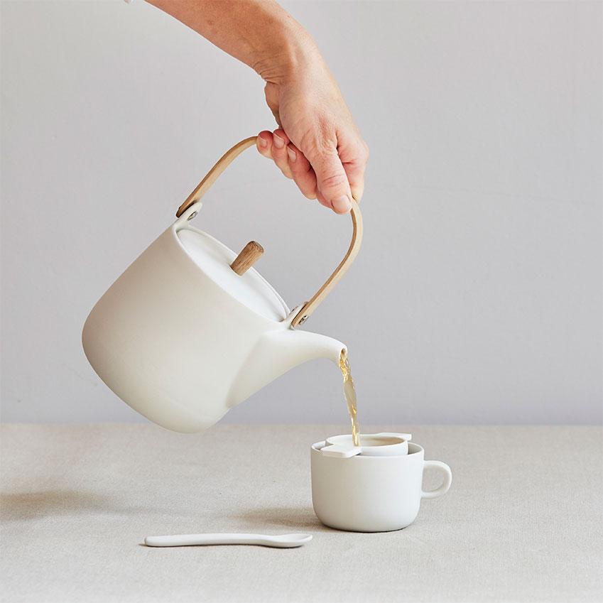 Handmade earthenware 'Mr & Mrs' teapot, £120; tea strainer; £35; tea cup, £30, all Sue Pryke