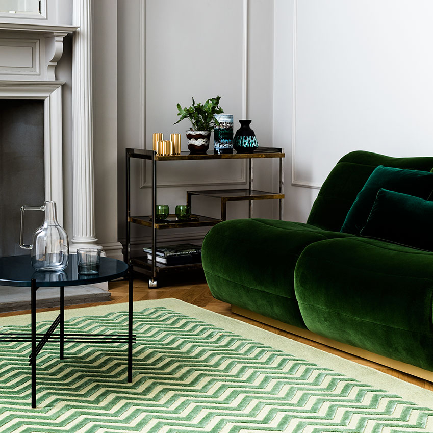'Penta' silk rug, £12,480, Vanderhurd. Green 'Newman' sofa, £3,400, Munna. Styling Amanda Smith; photographer Ben Anders. First featured in the April 2017 'Decorating' issue.