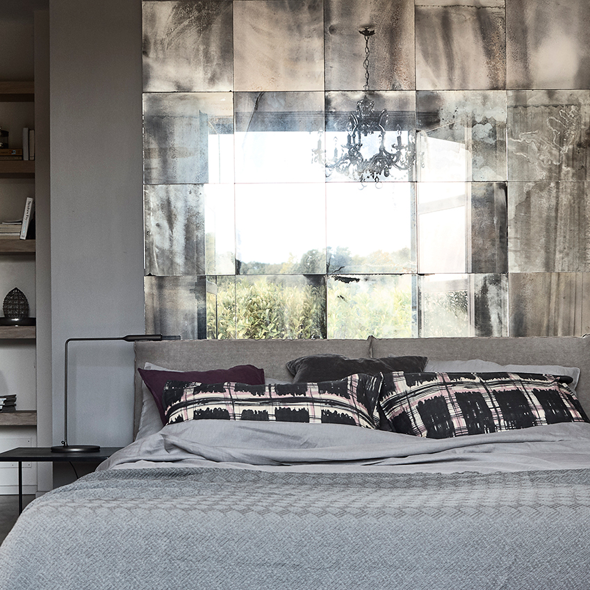 Bedroom with foxed-glass tiled headboard in an elegant Italian villa, first featured in ELLE Decoration Country Volume 10. Photographer Fabrizio Cicconi/Living Inside. Styling: Francesca Davoli