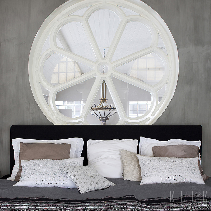 Use original architectural features as a starting point for a design, incorporating focal points such as this circular window – which overlooks the living space – into the scheme<span>Photography/Styling: Jeltje Janmaat/House of Pictures