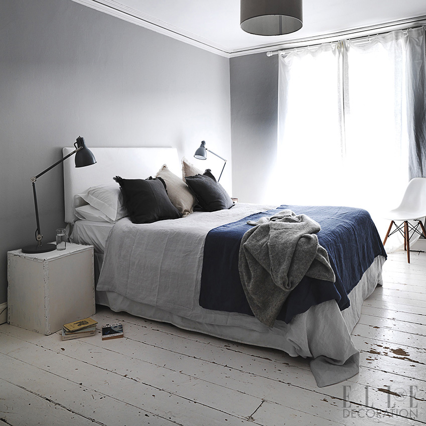 Distressed floorboards teamed with a neutral palette create a cool Scandinavian style. Choose simple furnishings – such as these twin bedside tables and reading lamps – to maintain the clean look<span>Photography: Michael Paul/Living Inside