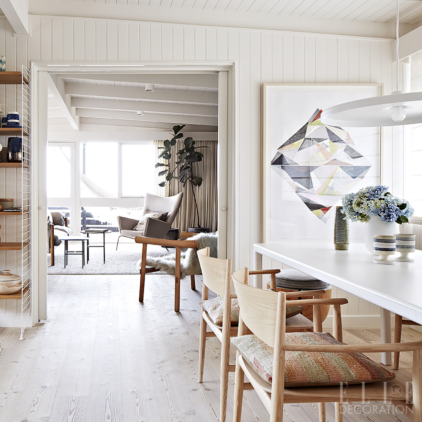 A mix of raw and white-painted wood creates an airy aesthetic in this Melbourne home. The double doors within the open-plan living-dining space can be closed off as desired for a more intimate feel<span>Photography: Armelle Habib  Styling: Heather Nette King</span>