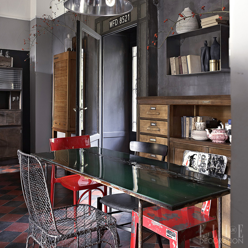 The owners of this Lake Como house made this table from an old door, which they coated in green resin. Reclaimed chairs and pendant lights add an industrial feel<span>Photography: Fabrizio Cicconi  Styling: Francesca Davoli/Living Inside</span>