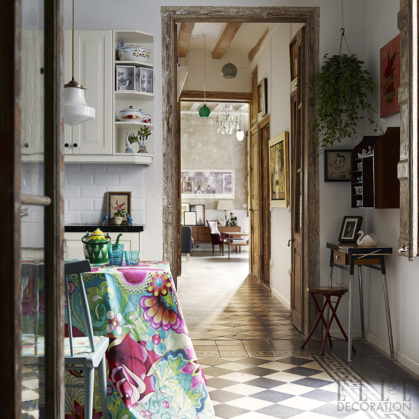The original tiled floors and rustic features of this traditional villa in the heart of Barcelona are enlivened by fabric in a bold print – the homeowner's own botanical design – that has been draped casually over the dining table<span>Photography: Fabrizio Cicconi/Living Inside  Styling: Francesca Davoli</span>