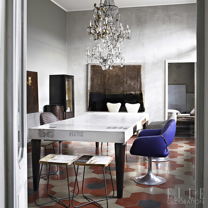 Crystal chandeliers create glamour – in this Italian home, clusters of lights hang above the dining table like glinting jewels. The quirky table is the homeowner's own bespoke design and the 1930s cement tiles are original to the house<span>Photography: Fabrizio Cicconi  Styling: Francesca Davoli/Living Inside