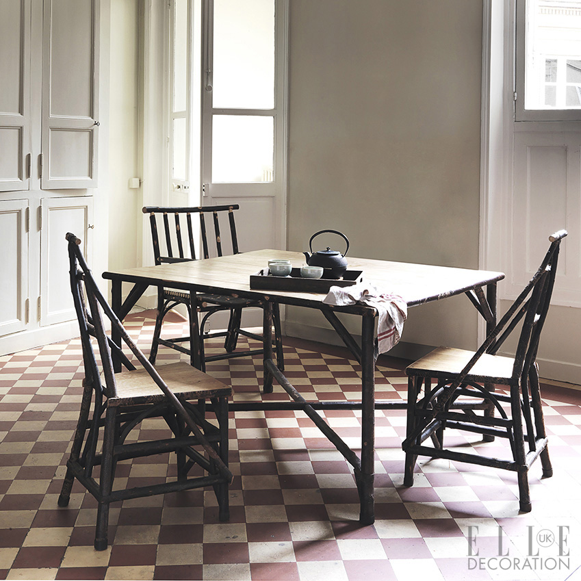 This eye-catching chequered tile floor creates a rustic French feel in this Parisian kitchen. For similar rustic tables and chairs, try Lombok (lombok.co.uk)<span>Photography: Michael Paul/Living Inside</span>