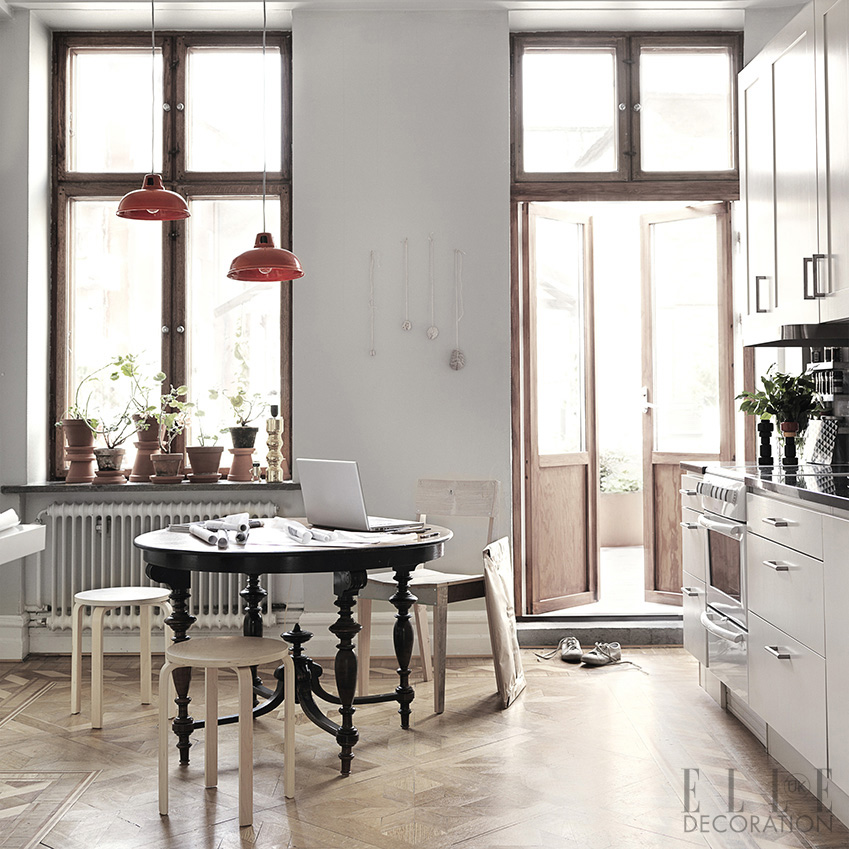 This kitchen has a galley-style layout, where cabinetry and appliances are placed along one wall, leaving enough floor space for a vintage table and chairs<span>Photography: Petra Bindel  Production/Styling: Emma Persson Lagerberg/House of Pictures</span>