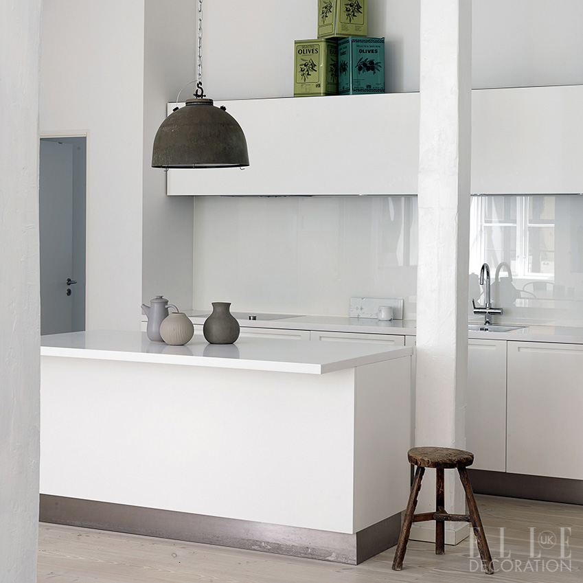 White units create a barely there aesthetic in this Copenhagen apartment. This Boffi cabinetry is designed with recessed handles that conserve the clean, streamlined lines; the units stand on metal plinths and reflect light, so they appear to levitate above the floor (boffi.com)<span>Photography: Karina Tengberg  Styling: Tami Christiansen/House of Pictures</span>