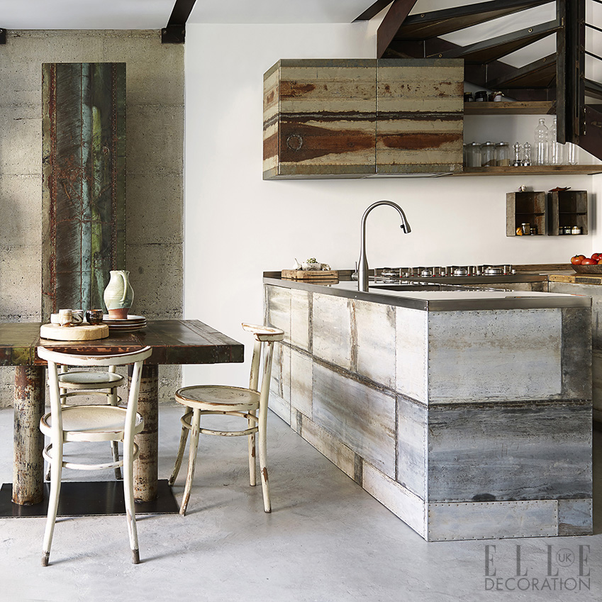 The cabinets in this kitchen – in a Milan apartment – are made from reclaimed galvanised iron with a stainless-steel countertop, creating an industrial vibe<span>Photography: Fabrizio Cicconi  Styling: Francesca Davoli/Living Inside</span>