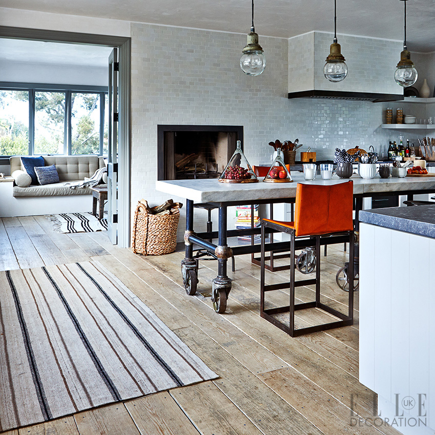 The island in this Californian family kitchen is a 20th-century bakery table that is paired with industrial lighting. The vintage Knoll chairs (knoll.com) have been updated in outdoor fabric so that they can be moved outdoors for al fresco dining<span>Photography: Martin Löf/Living Inside  Styling: Mira Fröling</span>