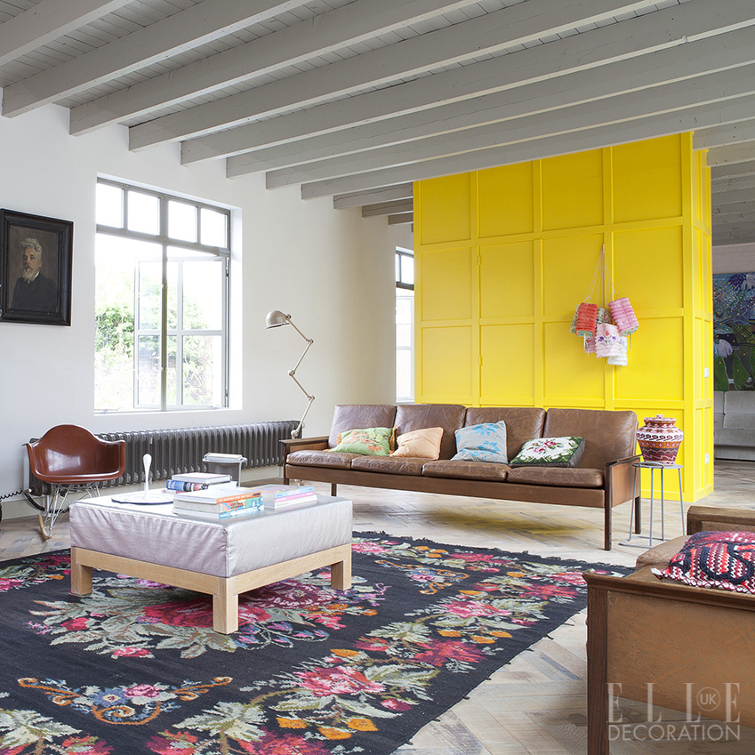 This former garage in the heart of historic s-Hertogenbosch in the Netherlands has been converted into a colourful and contemporary home-cum-workspace that is divided by reclaimed-timber walls and a vast mezzanine floor<span>Photography: Jean-Marc Wullschleger/Living Agency</span>