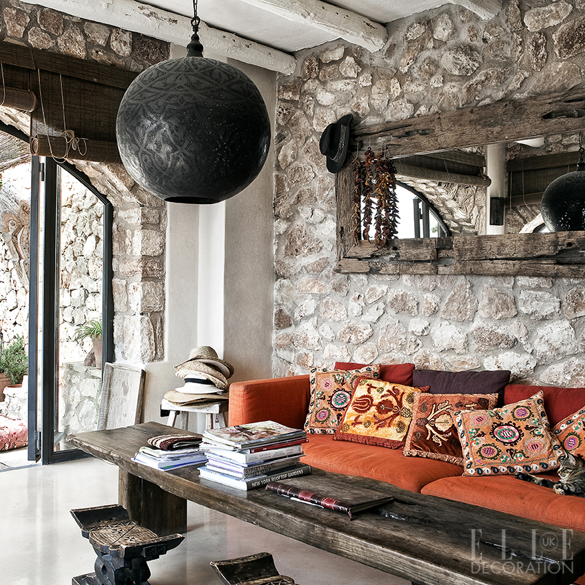 This Majorcan home doubles as a wellbeing retreat whose yoga-instructor owner has created a Moorish feel with pieces gathered from the souks of North Africa. Here, she has introduced colour by piling embroidered cushions on top of a vintage red sofa<span>Photography: Sunna & Marc van Praag</span>
