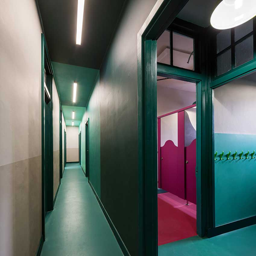 Rooms are demarcated from corridors by brightly coloured walls