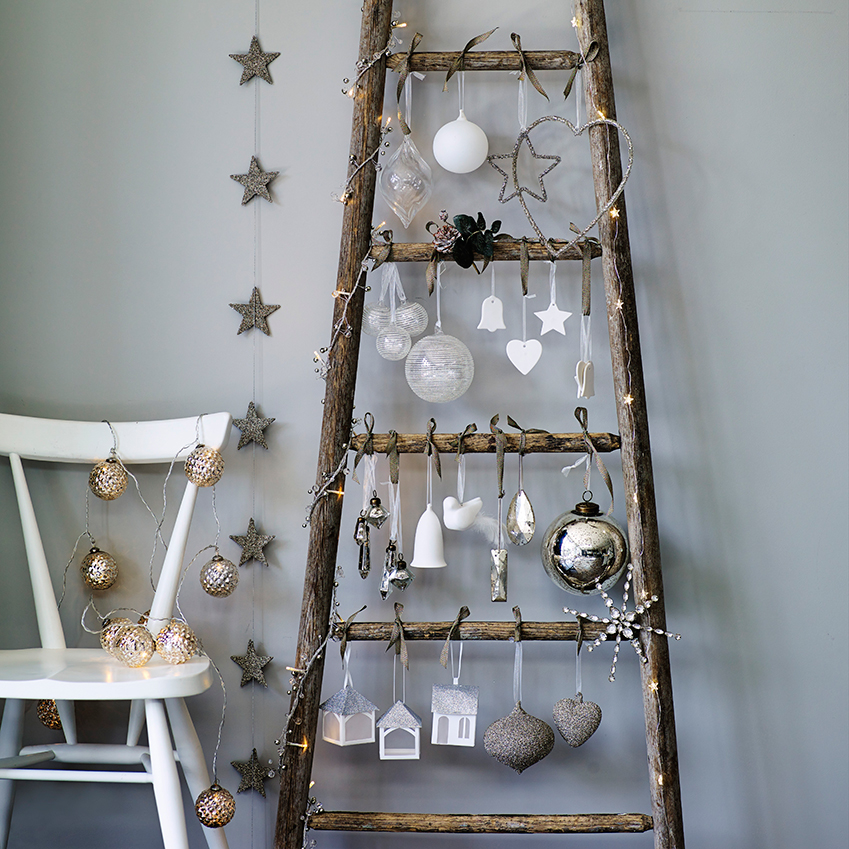 the white company an especially ingenious idea for small spaces hang baubles and lights - British Christmas Tree Decorations