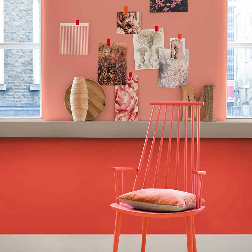 Zesty orange hues mixed with copper paintwork make for a fun, creative workspace