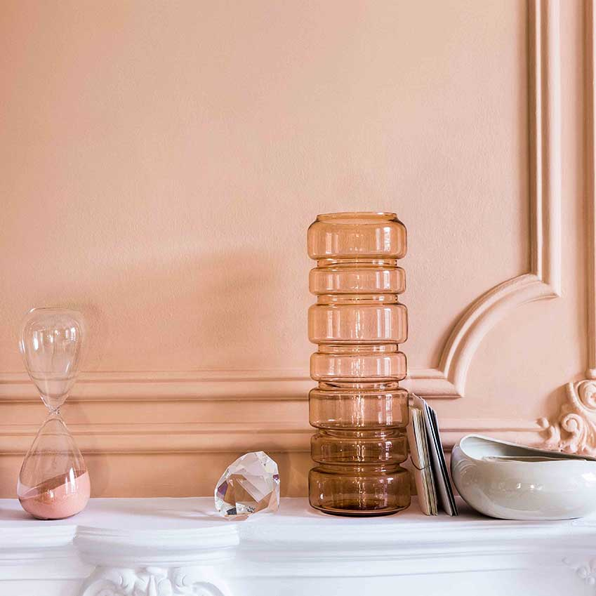 For a quieter scheme, opt for dusky pinks and translucent glass in combination with a copper accent wall