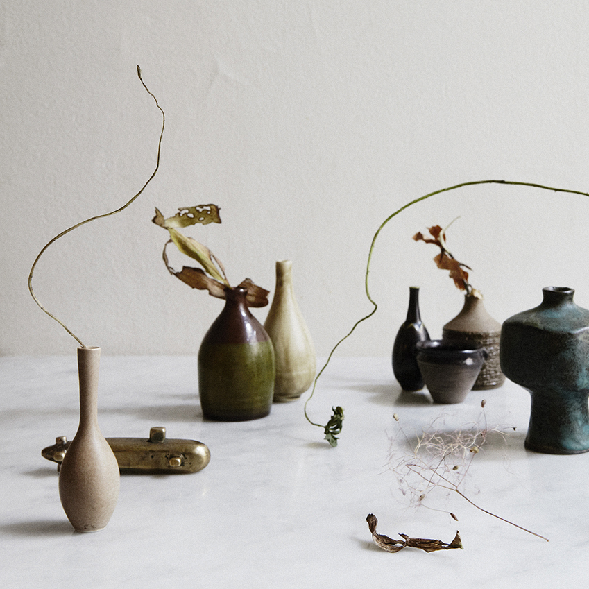 Sculptural ceramics work beautifully with dried flowers and plants for a stylish table display