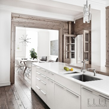 An island can become a practical kitchen designed in one compact unit if it includes an integrated sink, oven and worktop. Place it in the centre of a room to preserve original features in a classic home. This island is aligned with the dining table in the room beyond, so that it's easily accessible; both are finished in white to create a cohesive scheme throughout.  Photography: Sisters Agency