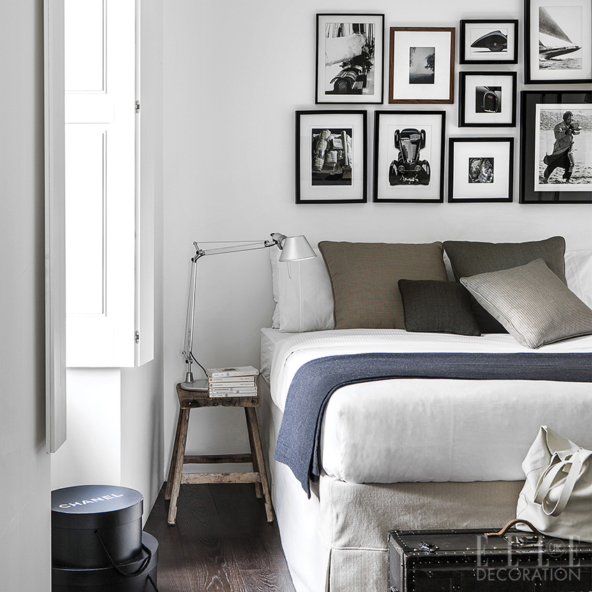 Hang framed black-and-white photography in random arrangements along one wall for a personalised design detail above a bed<span>Photography: Living Inside</span>
