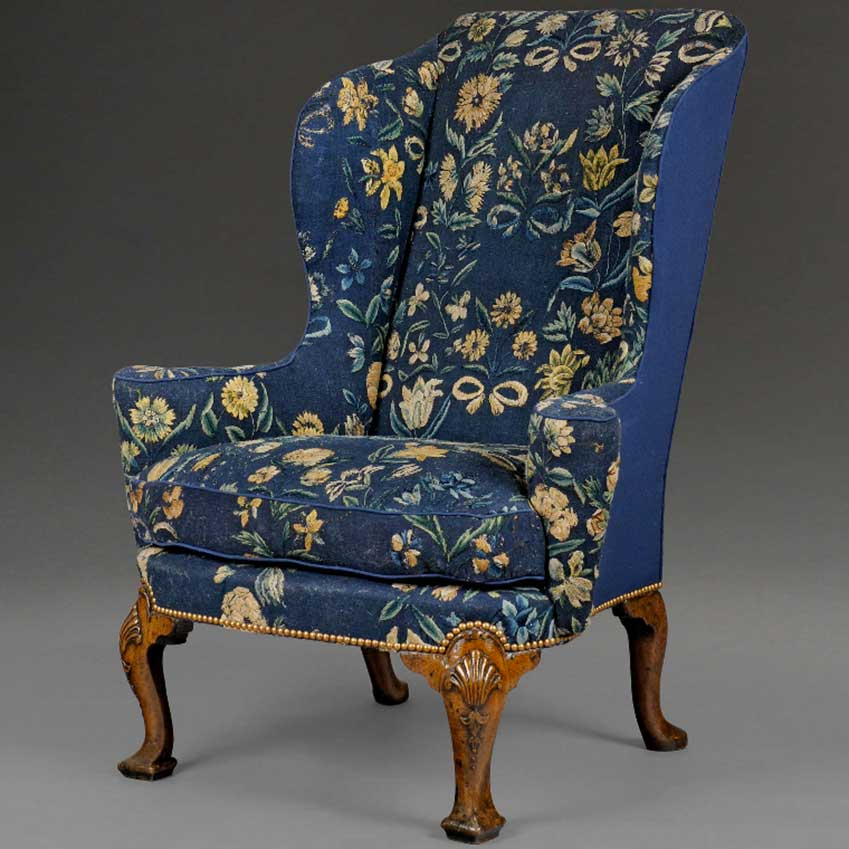 Queen Anne wing chair  (c. 1815) upholstered in silk and wool needlework, exhibited by Richard Courtney Ltd